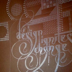 """if you missed the first edition laser cut of marian bantjes' """"Design Ignites Change"""" poster for aed social change design, be quick and get version 2 in silver foil on copper paper."""