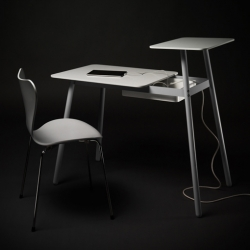 Two Step from Bao-Nghi Droste is a small working desk, ideal for home use. Two tabletop heights allow for both a standing and a seated work position.