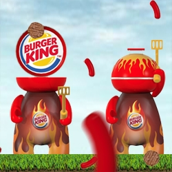 The barbecue grill, the grill head, is toy art transformed into a consumer product by Burger King in São Paulo. There's also a game concept! The grill head only eats hamburger, it does not like sausage.