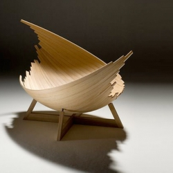 "Created by Jakob Joergensen the ""Barca""lounger was created by sliding around identical boards cut from Ash."