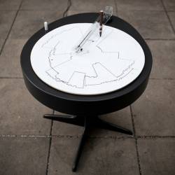 jacek barcikowski, jennifer kay and martina pagura from the copenhagen institute of interaction design present'sidetrack', a table which allows users to reflect on their working routine by drawing their pattern of behaviour.