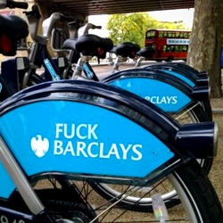 Obscene stickers found affixed to a number of rental cycles (part of London's new public bike-rental program). The stickers succinctly conveyed many Britons' anger toward the banking sector.