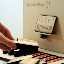 The Barcode Piano, both a musical instrument and toy for children to explore the principles behind barcodes through music.  A tangible interface that associates each number of a barcode with a musical tone.