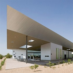 DeBartolo Architects designed The Commons, a social center for all activities  in a church campus. A big roof encloses the spaces, while generating open shaded spaces in the Arizona desert.