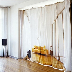 Bauke Knotterus has designed this very cool curtain that hides and devides a room. Printed with a gigantic photo of a sofa in a room.