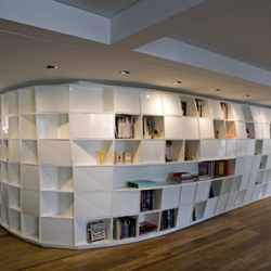 Bookshelves for Your Spaceship that Brazilian design firm Triptyque created for a private apartment in Sao Paulo.