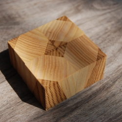Laser etched wooden cubes designed by collect.apply. Each set of 16 cubes can be arranged to make a number different patterns.