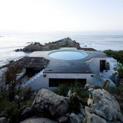Universe Beach House is beautiful beach house design with swimming pool as houses roof was designed by Tatiana Bilbao, located on the pretty shoreline of Mexico.