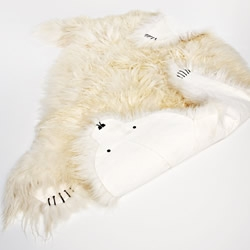 Ísbjörn / Ice Bear is a 3m 'full size' polar bear rug and is made from 15 Icelandic sheep skins