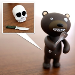 Crazy eyed bear wielding a spork? Beware! Check out the Rocket World T.A.D. Griz Lee Bear ~ so cute, so lost, so harmless? Or is he? Definitely adorably packaged though...