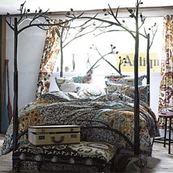 Stunning forest canopy bed over at anthopologie ~ tree beds make me think of the odyssey...