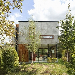 House GePo in Belgium designed by Open Y Office. Simple steel structure, minimalist, creates an open space on the ground floor that connects with a wild garden.