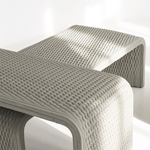 Studio 7.5 designed these stunning 3D printed woven concrete benches/tables. Printed with technology by XtreeE.