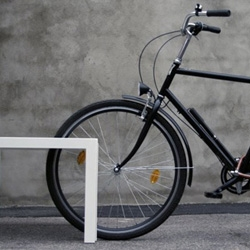 The Piano park bench by ADDI doubles as a bike rack.