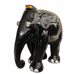 We've posted about London's Elephant Parade before, but Benjamin Shine;s taxi elephant deserved another post. It is glossy black with chrome details. headlights for eyes and a taxi sign that are solar powered!