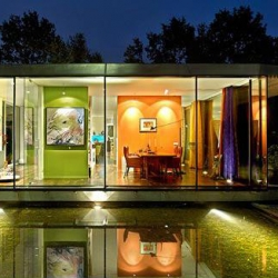 Luxury Villa Berkel is a stunning modern design by Dutch architect Paul de Ruiter, enclosed in large glass walls and referring to a simplicity that calm, but contemporary.