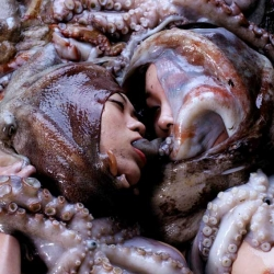 Daikichi Amano makes all kinds of weird films and photos involving girls with bugs, frogs, goldfish and eels, octopus.... all of which they eat afterwards, to avoid wasteful animal cruelty.