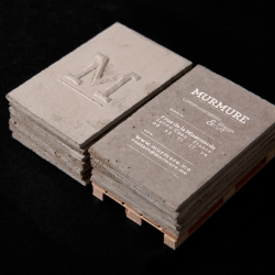 Murmure - Concrete (Béton) Business cards : Interaction between the scale and the material, the roughness of the support and the typographic and embossing refinements