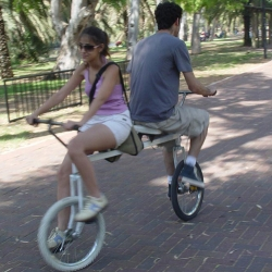 A unique tandem bicycle, Bi-Cycle - Since both riders can steer and pedal at the same time, riding this bike demands a trust bond between the riders.
