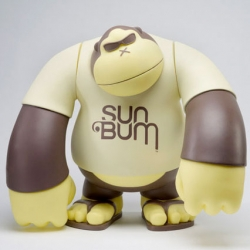"Bigshot Toyworks took Sun Bum's ""Ape Face"" logo and turned it into 16"" tall vinyl figures and 2.5"" keychains."