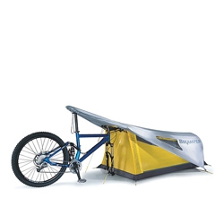 The Topeak Bikamper Designed is a one-person tent that uses your mountain bike's handle bars and front wheel rather than tent poles for support. It is made of waterproof, 45D ripstop nylon and even has windows!