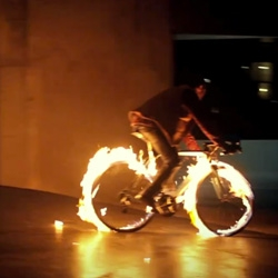 Crazy Frenchman rides a bike on fire