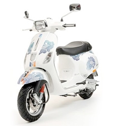Vespa S relooked by designer Paul & Joe... Really nice!