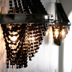Elaborate bicycle chain chandeliers by Carolina Fontoura Alzaga.