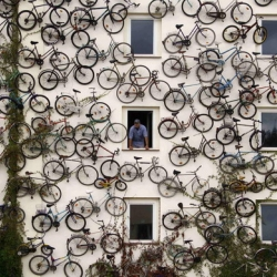 A bicycle shop in Altlandsberg, Germany advertises their goods with a wall of around 120 real bikes mounted on the building's exterior