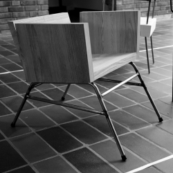 This is a new wooden lounge chair from Robert Janson. Made of solid elm and steel welded legs, for a project at the School of Architecture, Lund University.