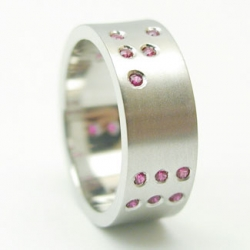 Seattled-based designer Sally Brock has created a great line of geeky jewelry, including amazing Binary Bands with gems.