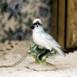 Chinny Chin Chin PORCELAIN JEWELERY - Stolen from old ladies sitting rooms and then shrunken to convenient fashion accessory size, these classic porcelain sculptures now fit around your neck.