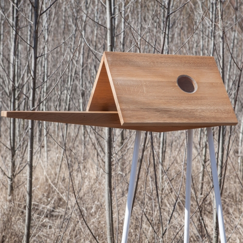 Birdwalk Bird Feeder by ODDO Architects, A modern bird house designed with an extended 'catwalk' section for optimal bird-watching opportunities.