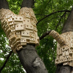 250 pixelated bird houses recently popped up on city trees in London.