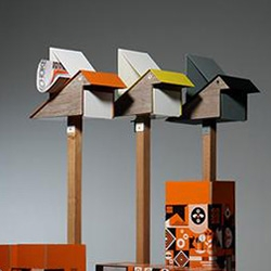Playsoo Koo Koo Letterbox/Mailbox - a stylised bird-shaped letterbox made of zinc and powder-coated metal with magnetic laminate wood side panels.