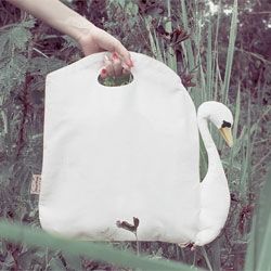 Birds of II feathers is a reversible bag that can be swan or cygnet. Made from sturdy cotton with embroidered features. By Mimi Pong.