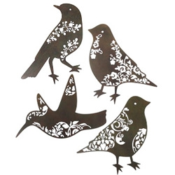 Give boring walls some flair with this unique set of 4 large metal filigree bird wall hangings.
