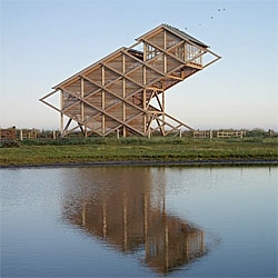 An impressive wooden structure for the Bird Watch Tower in Graswarder, Heiligenhafen. Designed by GMP Architekten.
