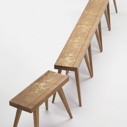 The bench is made from a single solid plank of oak wood. The plank is initially decorated with gold leaves then cut and turned into five stools. By placing the stools in the right order, it is possible to recreate the original plank of wood. By Ditte Hammerstrøm.