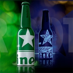 Heineken's very limited edition 16oz STR bottle ~ simple at first... toss it under a black light for the reveal!