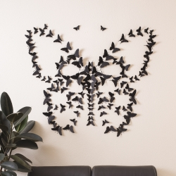 Handmade black wall butterflies by paper artist Jacqueline Jean. Cut and folded into bold 3D forms from fine art papers in a full palette of colors. Spring is coming.