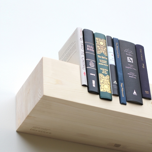 7,577,000,000 people 5,360 pages 3,700 years 206 countries 7 books 1 shelf. This unlimited edition of Juxtaposed: Religion commemorates the tenth anniversary of the original Juxtaposed shelf by Mike & Maaike for blankblank.