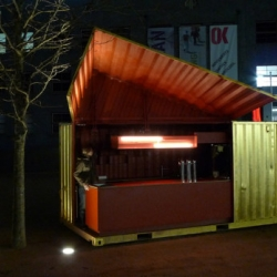 Mobile shipping container restaurants are making it big. This one in Linz, Austria is made from a 20 ft container, hinged hydraulic door that raises to reveal a just right bar outfitted with beer taps. Oh and it's gold-plated and totally blinged out.
