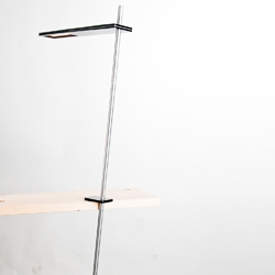 Balance OLED concept by Tore Bleuzé. Balancing on the edge of the table the luminaire draws attention due to its optical illusion.