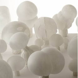 blown fabric by japanese designers nendo, these lamps are made of a thermoplastic, non-woven polyester fibre using a process similar to glass-blowing.