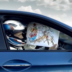 The Fastest Christmas Card in the World from BMW M shows an illustrator trying to draw while a new M5 whips around the Circuit de l'Anneau Du Rhin.