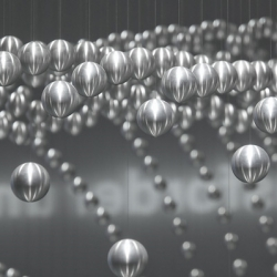 The Kinetic Sculpture made from 714 metal spheres, hanging from thin steel wires attached to individually-controlled stepper motors at the BMW Museum in Munich.