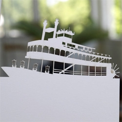 Laser cut wedding invite for a wedding followed by a riverboat reception.  Designed by Dave Koehler + Dylan Cole.