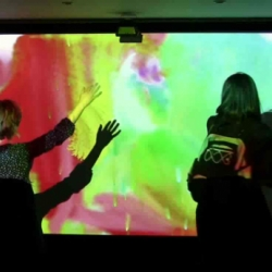 """""""Body Paint"""" by Mehmet Akten is an interactive installation and performance allowing users to paint on a virtual canvas with their body, interpreting gestures and dance into evolving compositions."""