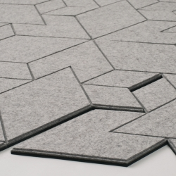 Citycapes Carpet by ALLT made from felt.  The rug pattern's is assembled from hexagonal grid tiles made from 100% wool.